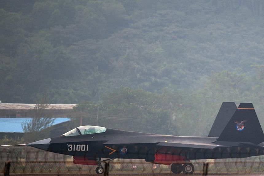 A Chinese J-31 stealth fighter taxis after a flight at the Airshow China 2014 in Zhuhai, south China's Guangdong province on Nov 11, 2014.China unveiled a sophisticated new stealth fighter jet at an air show on Tuesday, a show of muscle during
