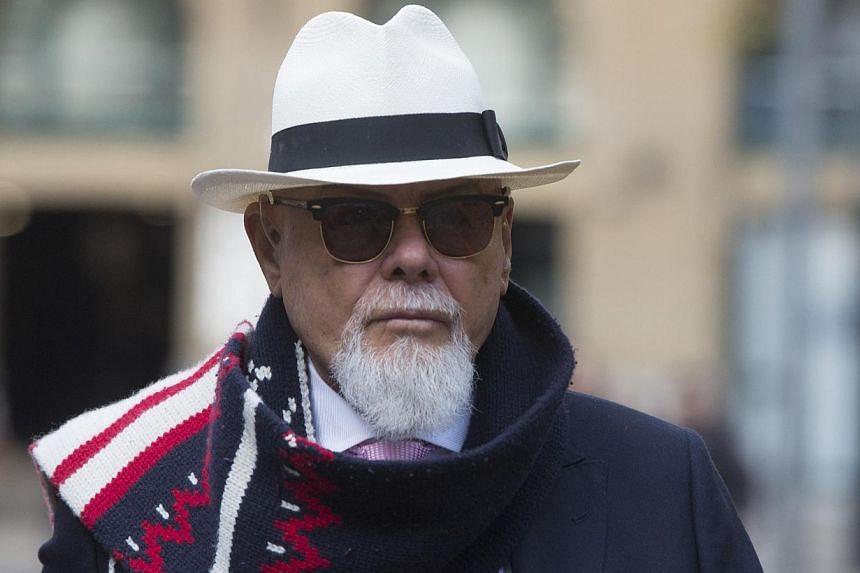 Gary Glitter, whose real name is Paul Gadd, arrives at Southwark Crown Court in London on Nov 11, 2014. The former British pop star denied a string of sex offences against three underage girls as he appeared in a London court Tuesday and will face tr