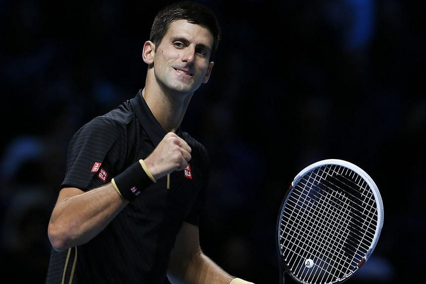 Novak Djokovic of Serbia celebrates after winning his tennis match against Marin Cilic of Croatia at the ATP World Tour finals at the O2 Arena in London on Nov 10, 2014. -- PHOTO: REUTERS