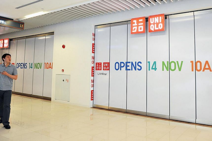A Uniqlo outlet that is set to open at One KM Mall in Tanjong Katong. One KM is one of three new malls slated to open by Christmas, and like some malls today, it counts Uniqlo among its anchor tenants.