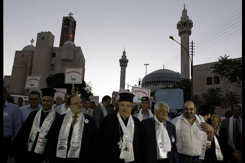Jordanian Christians and Muslims marching together in Amman in August, to condemn religious hatred. A proper approach to studying Quranic texts and Islamic history shows tolerance of non-Muslims was the norm.