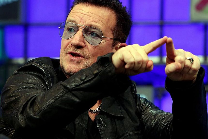 U2 frontman Bono speaks on centre stage during the last day of the Web Summit in Dublin, Ireland, on Nov 6, 2014. -- PHOTO: AFP