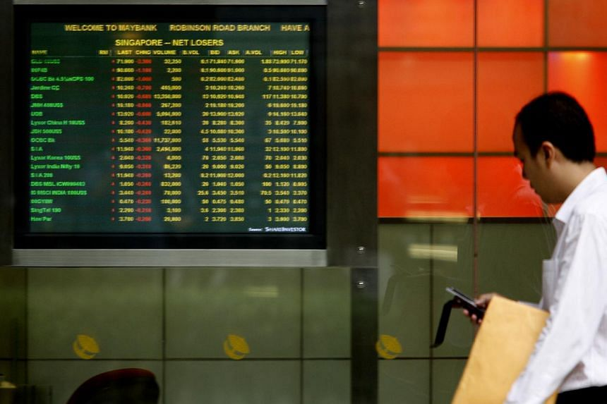 Shares fell on Tuesday, with the Straits Times Index (STI) closing 8.8 points or 0.3 per cent lower at 3,292.15. -- PHOTO: ST FILE