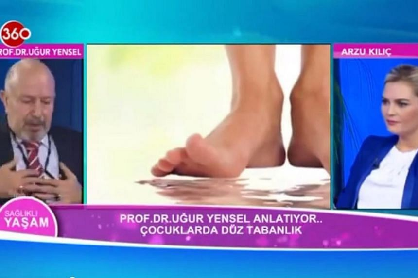 A screenshot from YouTube shows Dr Ugur Yansel clutching his chest. Dr Ugur Yansel, a professor of orthopaedics, was explaining flat feet in children when he had a heart attack during a live telecast of the hugely-popular Healthy Living (Saglikli Yas