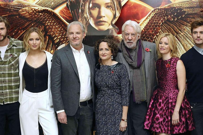 (From left) Cast members Liam Hemsworth, Jennifer Lawrence, director Francis Lawrence, producer Nina Jacobson, cast members Donald Sutherland, Elizabeth Banks and Sam Claflin attend the photocall for 'The Hunger Games: Mockingjay Part 1', in London o