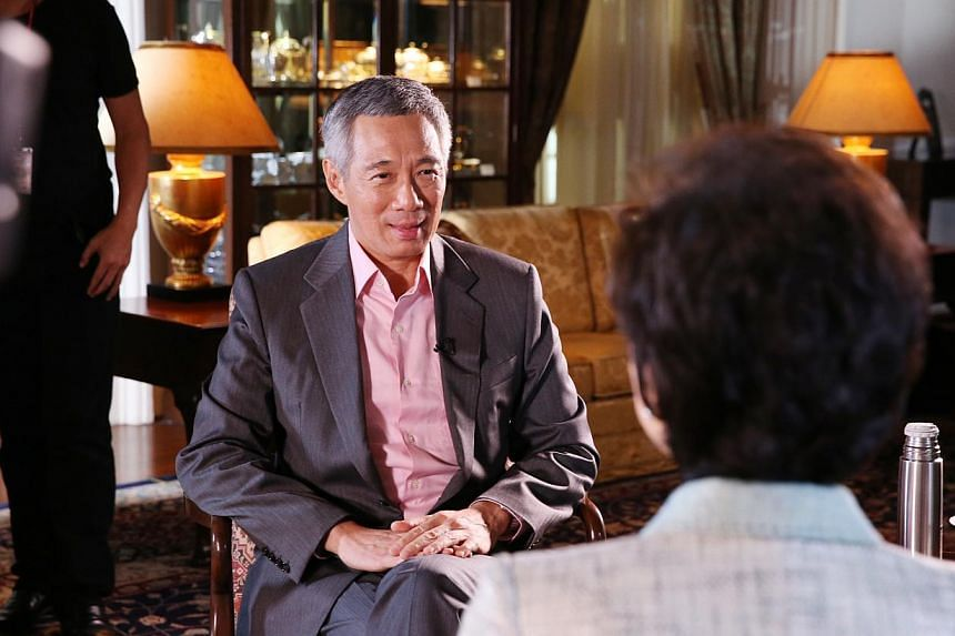 Prime Minister Lee Hsien Loong was interviewed by prolific Chinese media television host Yang Lan last week, ahead of the Asia-Pacific Economic Cooperation (Apec) summit in Beijing over the weekend. -- PHOTO: MINISTRY OF INFORMATION AND COMMUNICATION