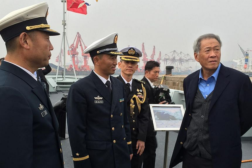 Defence minister Ng Eng Hen (right) toured the PLA Navy's newest missile corvette Fushun at the Qingdao naval base, which is the headquarters for the PLA Navy's North Sea Fleet. -- ST PHOTO: JERMYN CHOW