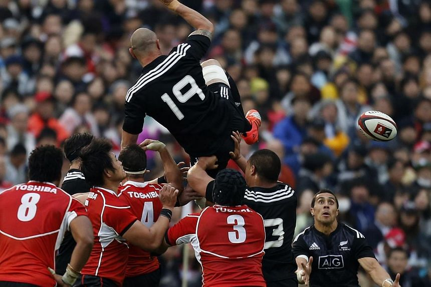 Japan's national rugby team (in red) taking on the New Zealand All Blacks in a test match in Tokyo on Nov 8. Japan have risen two places to an all-time high of ninth in the rugby world rankings after an impressive streak of 10 Test match victories, b