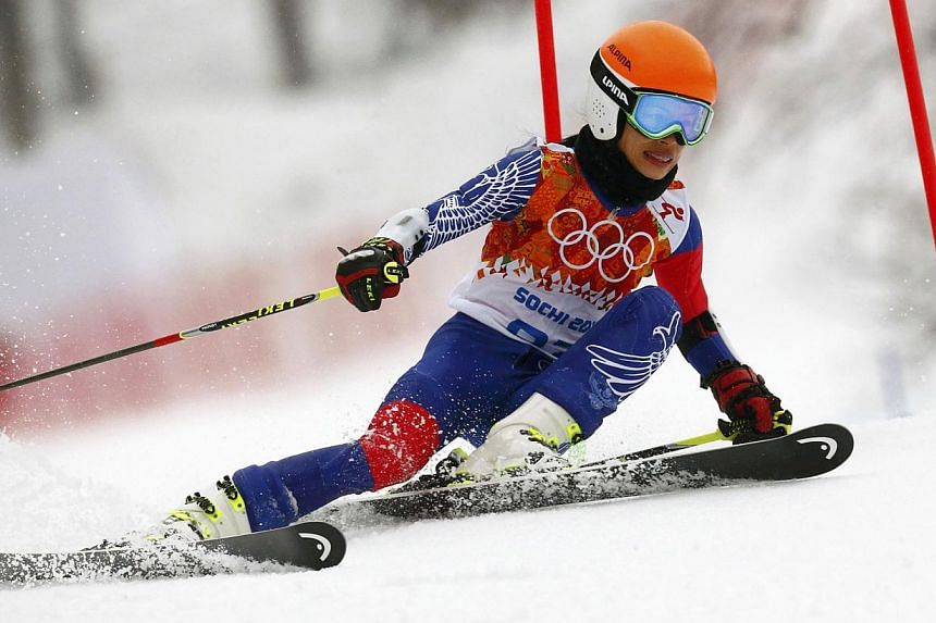 Pop violinist Vanessa Mae has been banned by the International Ski Federation (FIS) for four years over the manipulation of giant slalom races which allowed her to qualify for the Sochi Olympic Games. -- PHOTO: REUTERS