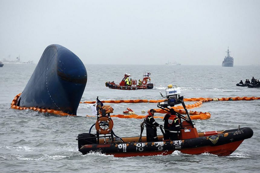 Rescue boats sail around the sunken South Korean passenger ship Sewol, in the sea off Jindo, on April 17, 2014. -- PHOTO: REUTERS