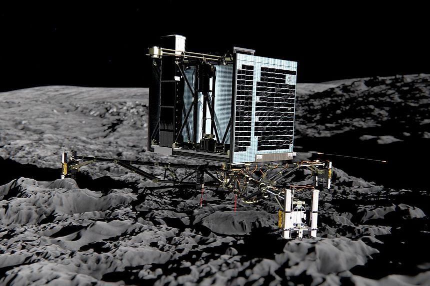 This photo released by the European Space Agency on Dec 20, 2013, shows an artist impression of Rosetta's lander Philae (back view) on the surface of comet 67P/Churyumov-Gerasimenko. -- PHOTO: AFP/ESA MEDIALAB