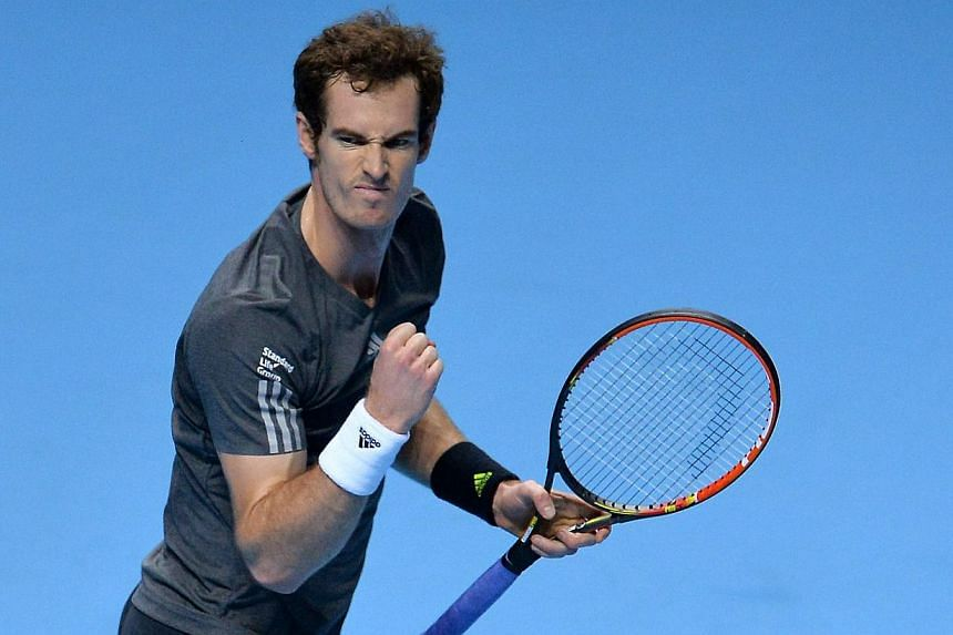 Britain's Andy Murray celebrates match point against Canada's Milos Raonic during their Group B singles match on day three of the ATP World Tour Finals tennis tournament in London on Nov 11, 2014. -- PHOTO: AFP