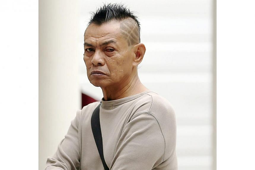 Abdul Rahman Ibrahim, 64, has been accused for using a mini samurai sword to slash Yun Yew Lee, on his left forearm and his back. -- ST PHOTO: WONG KWAI CHOW