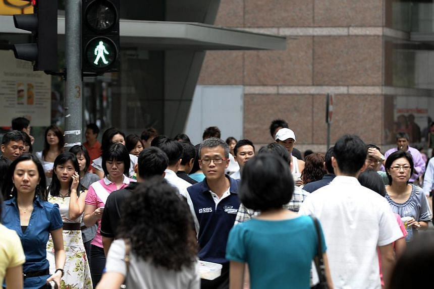 """The survey found that Singapore workers agreed most with the statement """"I am confident in doing my job"""" and least with the statement """"I like how things work in my company"""". -- PHOTO: ST FILE"""