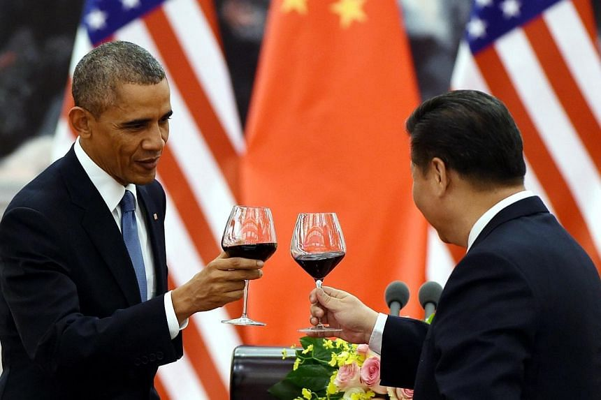 US President Barack Obama (left) and Chinese President Xi Jinping (right) drink a toast at a lunch banquet in the Great Hall of the People in Beijing on Nov 12, 2014. -- PHOTO: AFP
