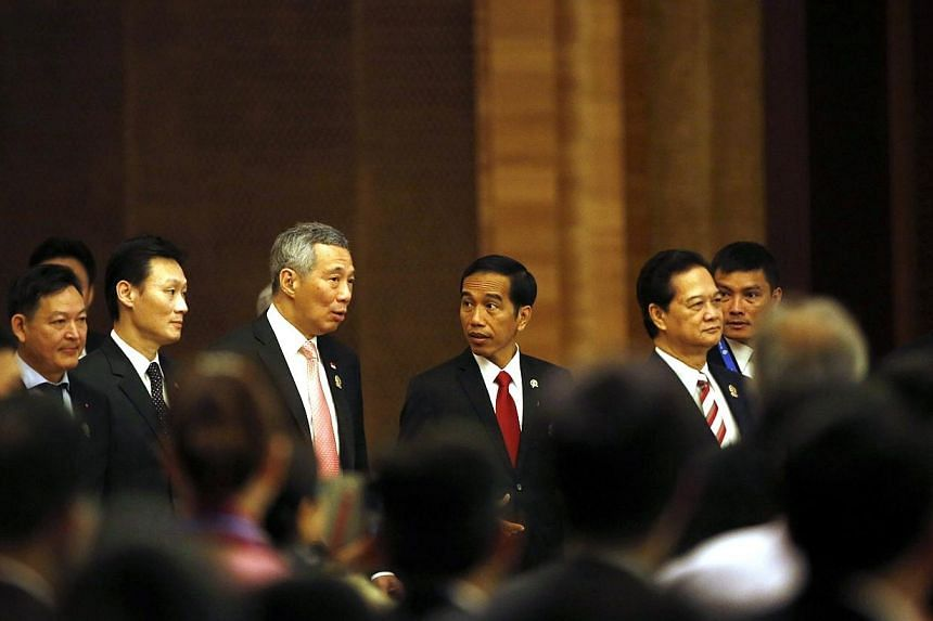 Singapore's Prime Minister Lee Hsien Loong (third right) and Indonesia's President Joko Widodo as they arrive at the opening ceremony of 25th ASEAN Summit in Myanmar International Convention Centre at Naypyitaw on Nov 12, 2014. -- PHOTO: REUTERS