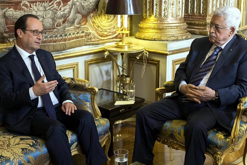 French president Francois Hollande (left) speaks with Palestinian president Mahmoud Abbas at the Elysee presidential palace on Sept 19, 2014, in Paris. French lawmakers will vote on Nov 28 on a proposal by the Socialist Party urging the governme