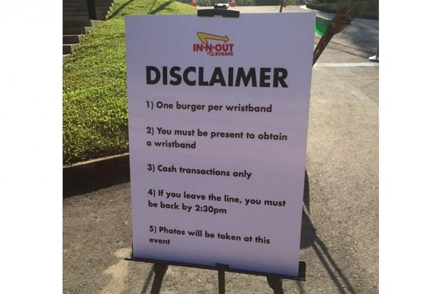 A disclaimer placed outside the In-N-Out Burger pop-up store in Singapore on Nov 12, 2014. -- ST PHOTO: AUDREY TAN