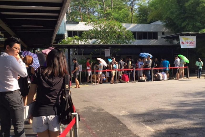 Eager fans of In-N-Out Burger pop-up store turned up at Timbre@Gillman hours before the store opens at 11am. -- ST PHOTO: AUDREY TAN
