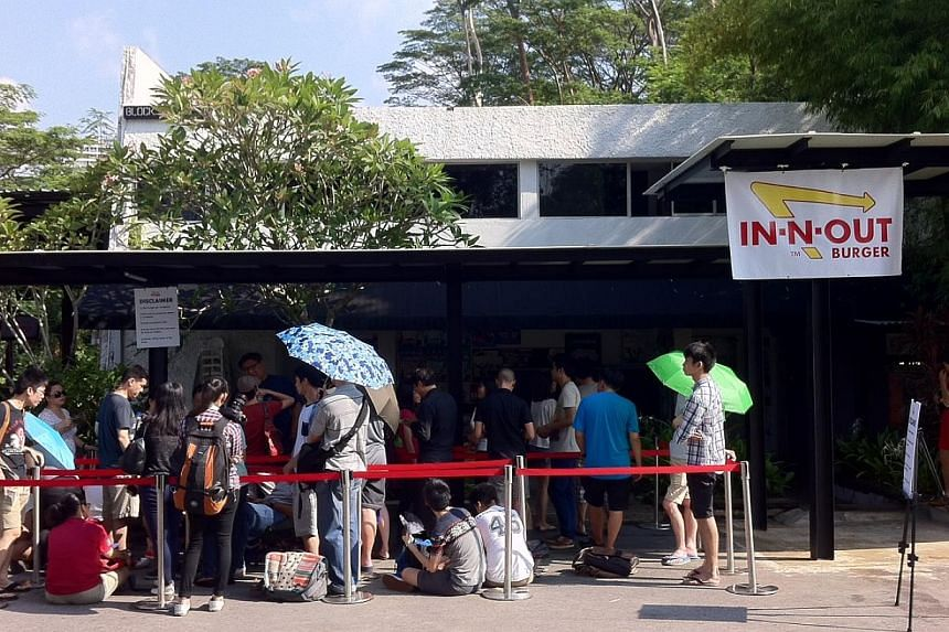 The queue of eager fans at In-N-Out Burger pop-up store at Timbre@Gillman on Nov 12, 2014. -- ST PHOTO: DESMOND LIM