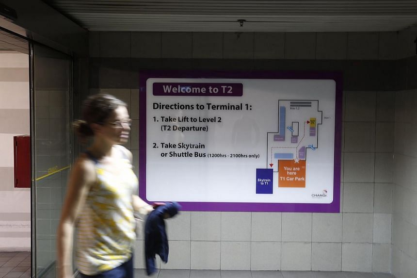 New signs within the T2 carpark telling drivers how to get back to T1 on November 12, 2014.-- ST PHOTO: KEVIN LIM