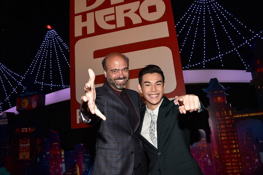 Actor Scott Adsit (right), who is the voice behind Big Hero 6's Baymax, and Ryan Potter (far right), the voice of engineering whiz Hiro Hamada, at the film's premiere in Hollywood, California, earlier this month. Hayao Miyazaki's My Neighbour Totoro.