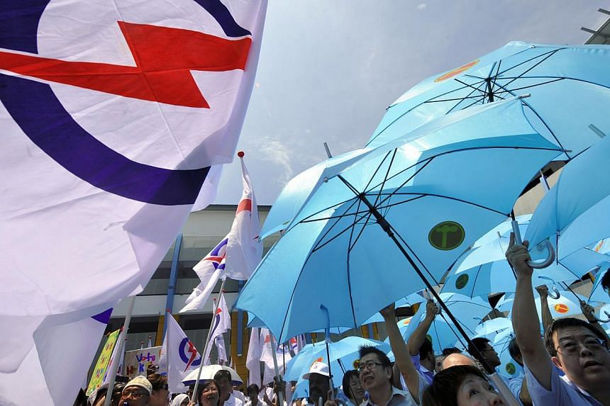 Supporters of the PAP (left) and WP on Nomination Day in 2011. The next GE will almost certainly be a straight fight between the two parties, providing some indication of whether Singapore is evolving from a one-party dominant to a two-party politica