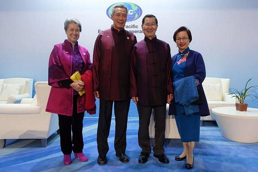 "PM Lee and wife, Ho Ching, take a picture with Mr and Mrs Vincent Siew. Mr Siew was representing ""Chinese Taipei"" at the 2014 Apec economic leaders' meeting. The picture was posted on the prime minister's Facebook page on Nov 12, 2014. -- PHOTO"