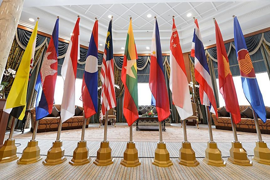 The Asean flag as well as flags of Asean member states on display at the Prime Minister's Office Building Complex in Bandar Seri Begawan, Brunei. -- PHOTO: BT FILE
