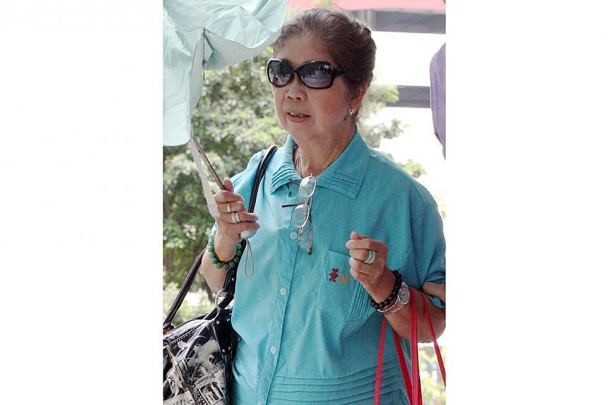 Madam Fong Quay Sim, seen here in a 2010 file photo, spent a year in jail for poisoning her husband with arsenic.-- PHOTO: ST FILE