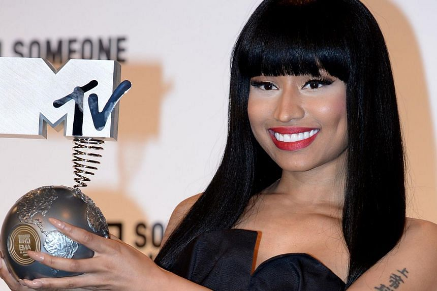 US rapper Nicki Minaj poses for pictures after being awarded the title 'Best Hip Hop' during the 2014 MTV Europe Music Awards in Glasgow, Scotland, on Nov 9, 2014. Minaj apologised on Tuesday and denied any Nazi sympathies after she came under critic