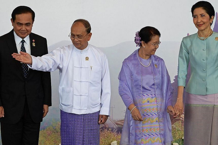 Myanmar President Thein Sein (second from left) and his wife Khin Khin Win (second from right) welcome Thailand's Prime Minister Prayuth Chan-Ocha (left) and his wife ahead of the 25th Asean Summit at the Myanmar International Convention Centre in My