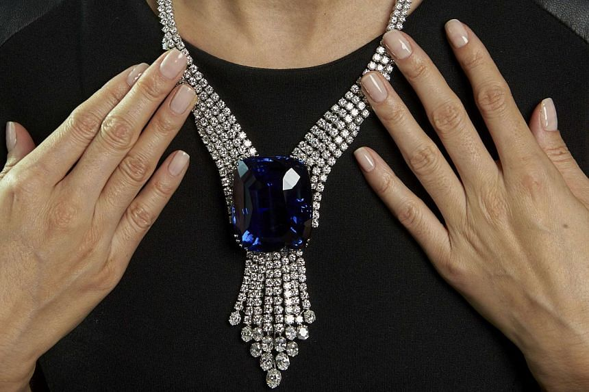 """A Swiss auction has set a new world record for jewellery sales, Christie's said on Wednesday, led by a Ceylon sapphire known as the """"Blue Belle of Asia"""" that alone sold for an unprecedented 16.96 million Swiss francs (S$22.7 million). -- PHOTO: REUTE"""