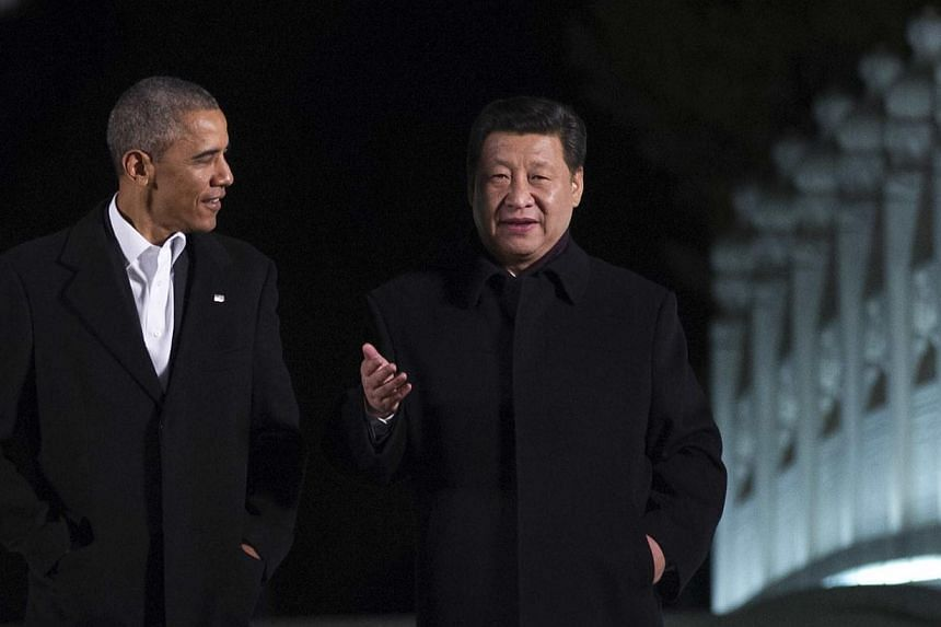 US President Barack Obama (left) walks with China's President Xi Jinping at the Zongnanhai leaders compound, ahead of a dinner in Beijing on Nov 11, 2014. The United States and China are planning to announce military agreements aimed at reducing the