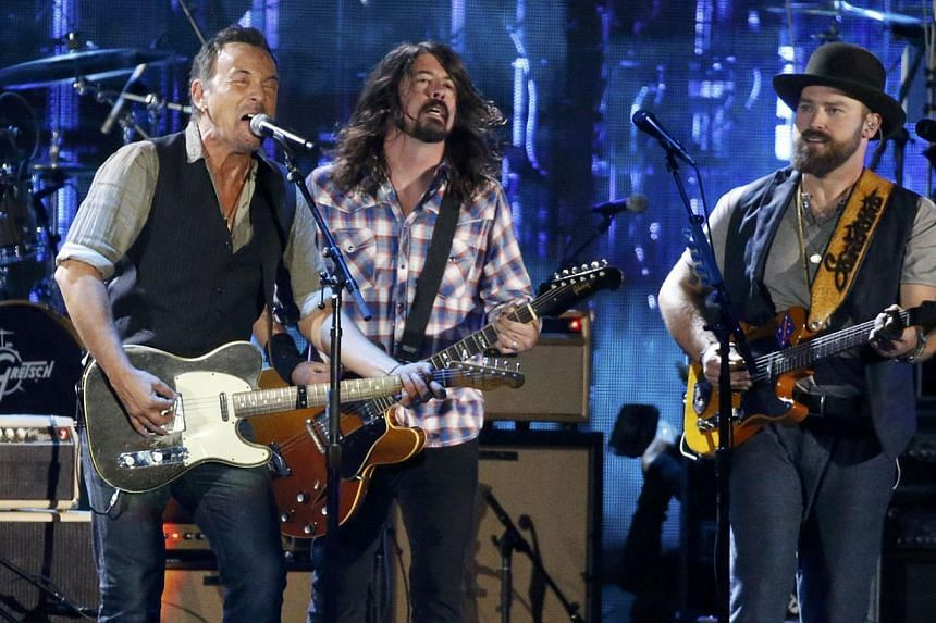 Musicians Bruce Springsteen (L), Dave Grohl and Zac Brown (R) perform during The Concert for Valor on the National Mall on Veterans' Day in Washington. -- PHOTO: REUTERS