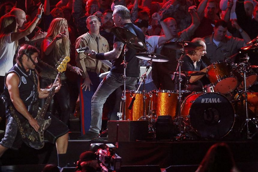 Metallica performs with US military personnel and veterans during the Concert for Valor on the National Mall on Veterans' Day in Washington on Nov 11, - - PHOTO: REUTERS