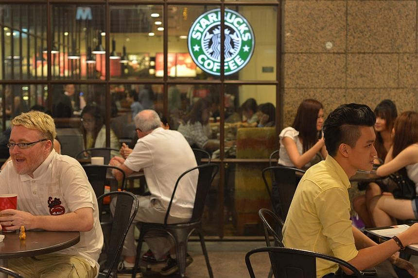 Starbucks Coffee patrons at the Bugis Junction outlet. -- ST PHOTO: CAROLINE CHIA
