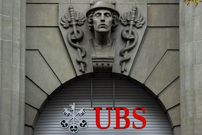 A file photo taken on October 15, 2011 shows the logo of the Swiss banking giant UBS seen above its headquarters in downtown Zurich. -- PHOTO: AFP