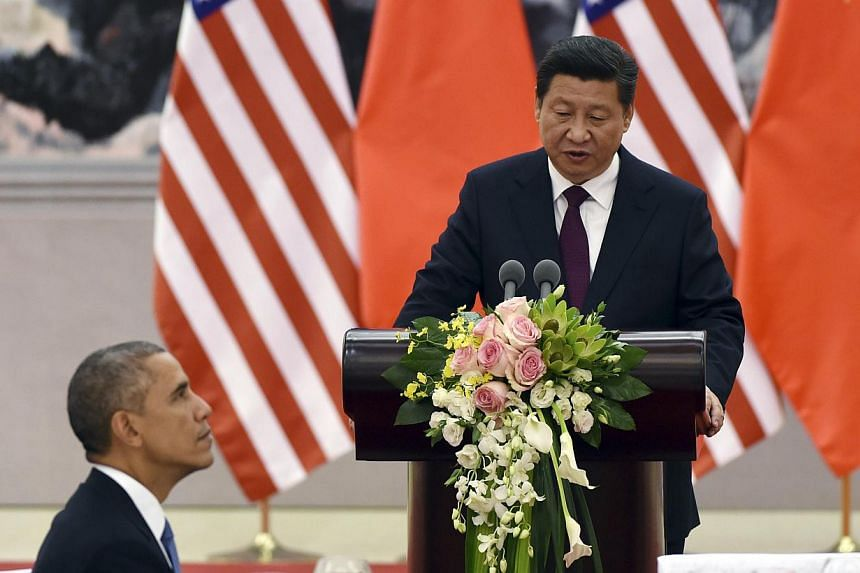 Chinese President Xi Jinping speaks at a lunch banquet with US President Barack Obama (left) in the Great Hall of the People in Beijing, China on Nov 12, 2014. -- PHOTO: REUTERS