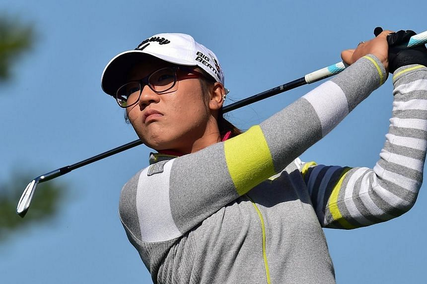 Lydia Ko of New Zealand tees off at the 3rd hole during the first round of the LPGA KEB-HanaBank Championship golf event at the Sky72 Golf Club in Incheon, west of Seoul, on Oct 16, 2014.New Zealand teenager Lydia Ko has become the youngest win