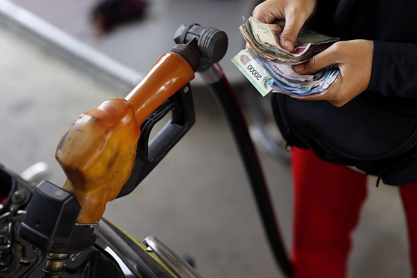Indonesia's new government is rethinking the timing and size of a rise in subsidised fuel prices following a sharp drop in global oil prices, the vice president's office said on Thursday.