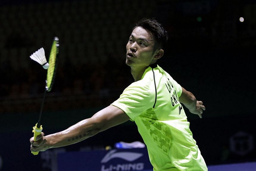 Lin Dan of China returns a shot against Hsu Jen Hao of Taiwan during the men's singles first round of the Badminton China Open held in Fuzhou, China's Fujian province on Nov 12, 2014.Chinese badminton superstar Lin Dan says he hopes world No. 1
