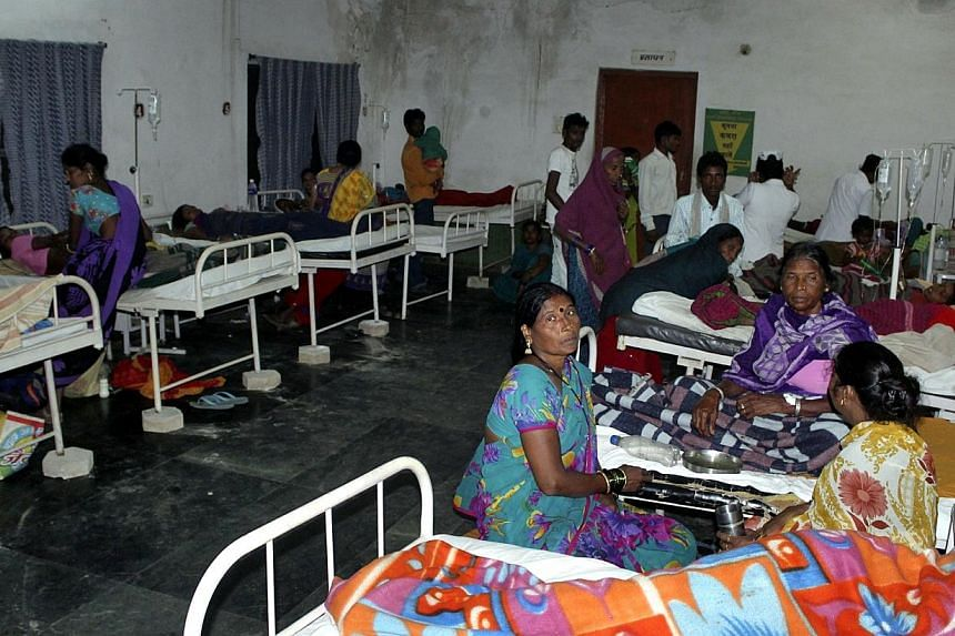 """Women who underwent botched sterilization surgeries at a government mass sterilization """"camp"""" receive treatment at a district hospital in Bilaspur, in the eastern Indian state of Chhattisgarh on Nov 10, 2014.The doctor whose sterilisation of 83"""