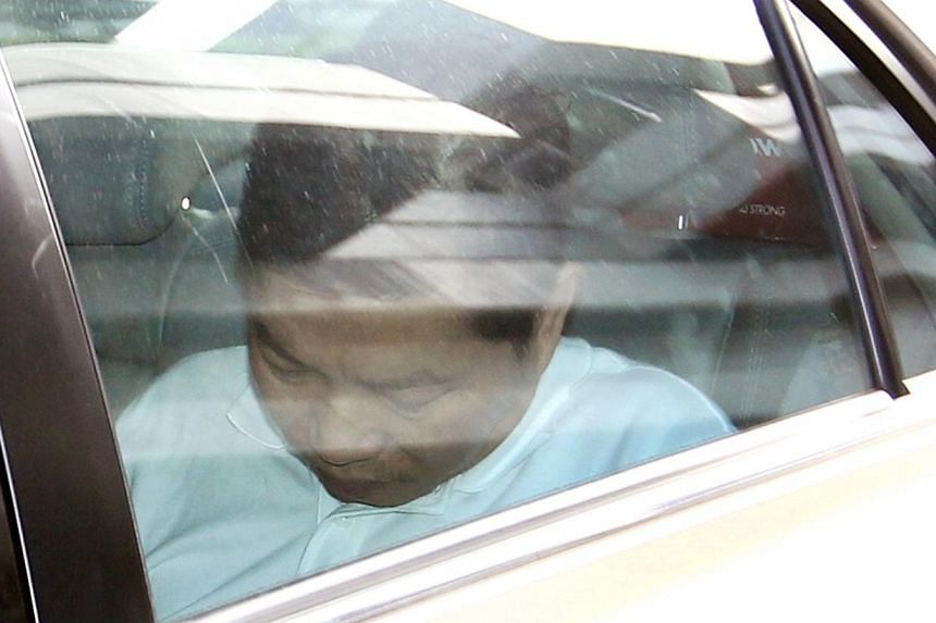 Chia Kee Chen in a car outside the Subordinate Courts on Jan 2, 2014. Chia, who is facing a murder charge of killing a raw materials planner in Choa Chu Kang last December, had another charge slapped on him on Thursday - conspiring with two others to