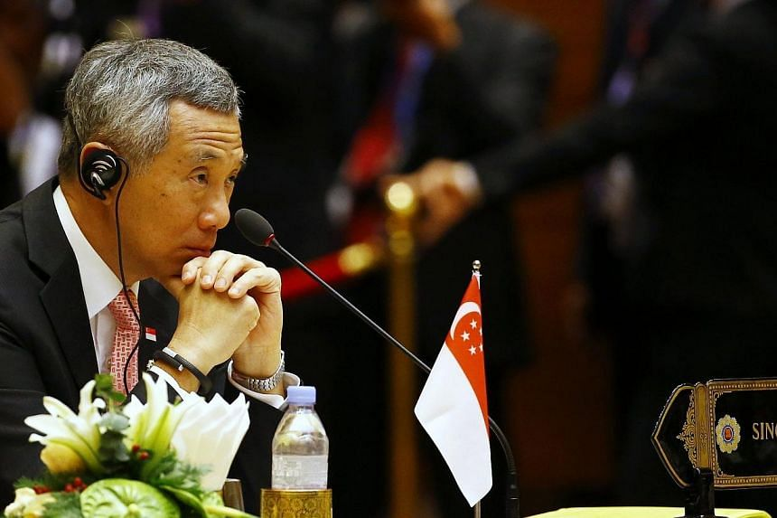Singapore's Prime Minister Lee Hsien Loong listens to the speech during the plenary session of the 25th ASEAN summit at Myanmar International Convention Centre in Naypyitaw on Nov 12, 2014. -- PHOTO: REUTERS