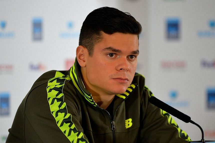 Canada's Milos Raonic has withdrawn from the ATP Tour Finals in London owing to injury and been replaced by Spain's David Ferrer. -- PHOTO: AFP