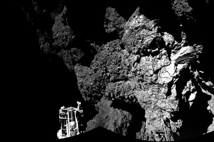 """A new image shows the view from the Philae lander of the surface of the comet.Europe's robot lab Philae was """"working well"""" on the surface of its host comet, though likely perched on a steep slope, ground controllers said a day after the probe m"""