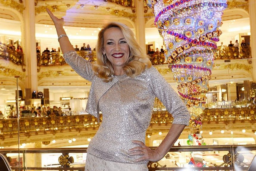 Jerry Hall, former US model, poses as she inaugurates the Christmas tree of the Galeries Lafayette department store on Nov 05, 2014, in Paris. -- PHOTO: REUTERS