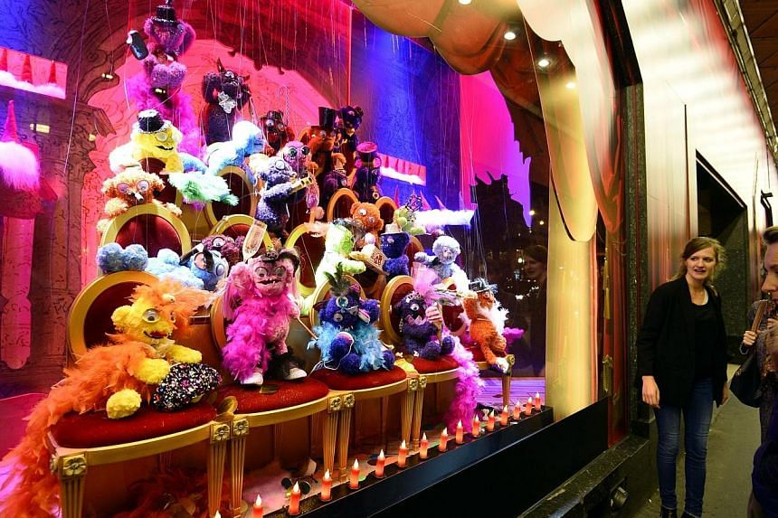A Monster show is presented in a christmas animated shop window of the Galeries Lafayette department store on Nov 5, 2014, in Paris. -- PHOTO: AFP