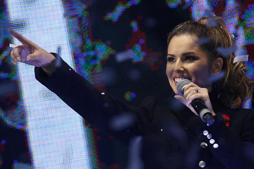 Singer Cheryl Fernandez-Versini reacts after switching on the Oxford Street Christmas Lights in London on Nov 6, 2014. -- PHOTO: REUTERS